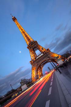 <b>France, Paris</b>, Eiffel tower with car s light tracks